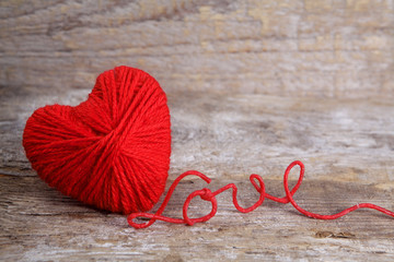 Heart-shaped ball of yarn, with words of love thread
