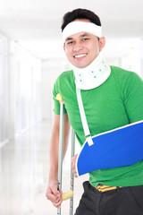 injured young man keep smile