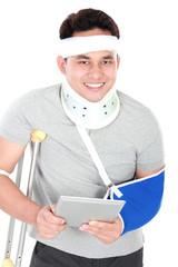 injured young man play gadget
