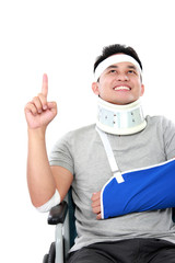 young man with broken arm pointing upwards