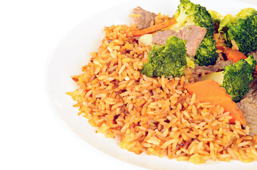 Beef meat, broccoli, carrots and rice with soy sauce on white pl