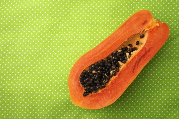 Papaya on the green background