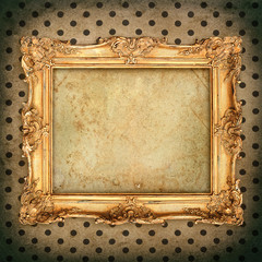 antique picture frame over aged wallpaper. vintage grunge backgr