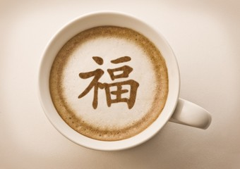 chinese new year blessing letter on latte art coffee cup