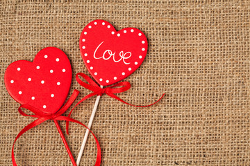 Red valentine's day hearts on vintage textile background