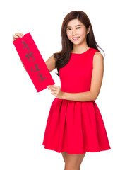 Woman hold with Fai Chun for chinese new year, phrase meaning is