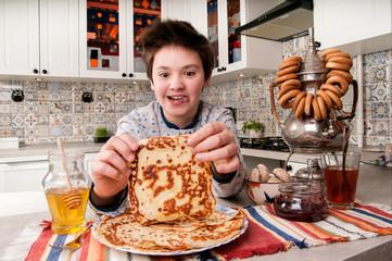 Boy eats the pancakes