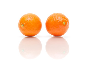 two tangerine isolated on white background with reflection