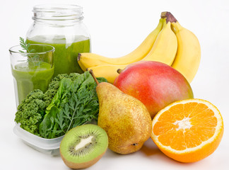 Green Smoothie With Leafs And Fruits