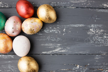Easter eggs on wooden table. Holiday background