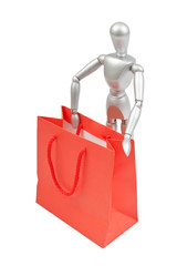 Silver mannequin human model with shopping bags in red