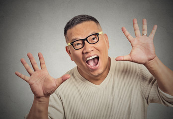 super excited funky guy with glasses looking at you arms raised