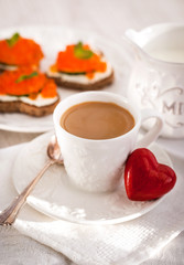 Romantic breakfast with coffee and toasts