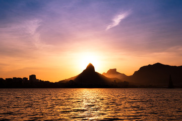 Wall Mural - View of Rio de Janeiro Sunset Behind Mountains at the Lake