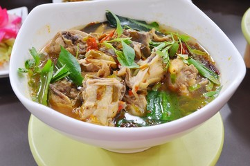 Thai food - Spicy chichken soup with herbs