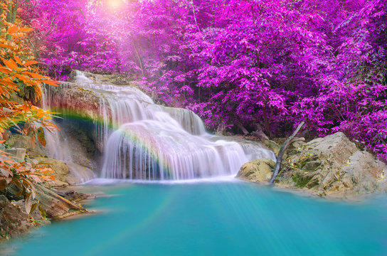 Wonderful Waterfall with rainbows in deep forest at national par
