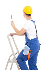 back view of young man builder in blue coveralls with screwdrive