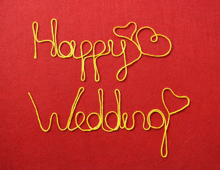wedding ribbon greeting and hearts on red background
