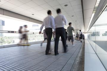 people walking through the airport corridor