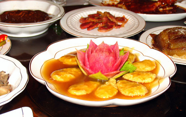 Vegetarian dishes on festive table in chinese buddhist monastery