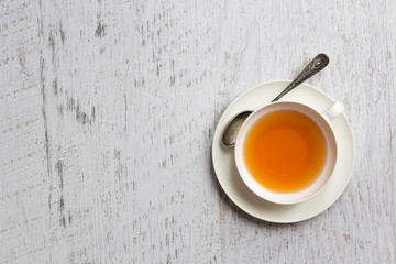 Cup of tea on white background, top view point
