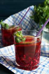 Pomegranate drink in glasses with mint and slices of lime