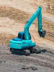 A large trackhoe moving rock
