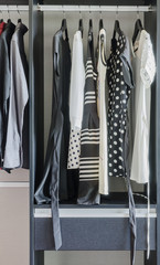 row of black and white dress in wardrobe