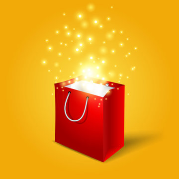 Red shopping bag with magic light fireworks from it
