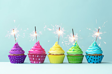 Wall Mural - Colorful cupcakes with sparklers