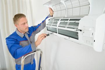 Repairer Repairing Air Conditioner