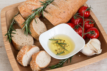 Bread with olive oil ,rosemary on the wooden plate