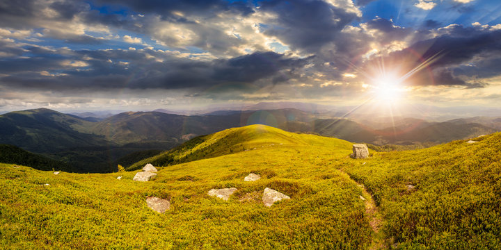 path among stones on mountain top at sunset
