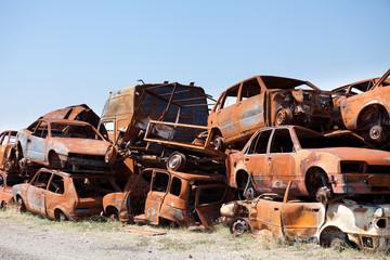 Stack od dameged rusted car scraps on junkyard