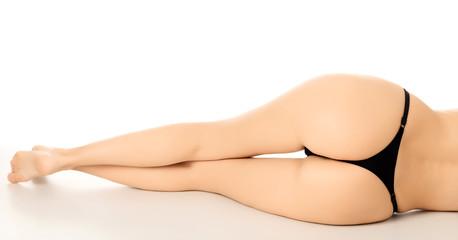 Nice female backside and long legs, white background.