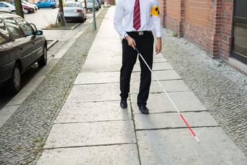 Blind Man Walking On Sidewalk