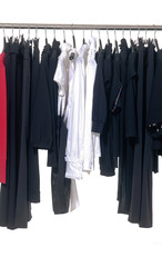 Set of female clothing with trousers hanging a on display