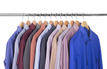 variety of shirts on wooden hangers
