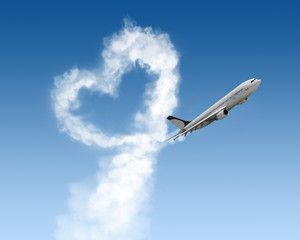 heart shape of track from plane on blue