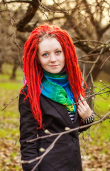 the girl with red dreadlocks in park