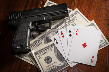 Card with money and gun.