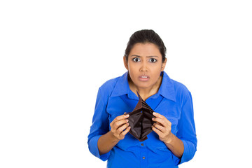 unhappy young woman standing showing empty wallet