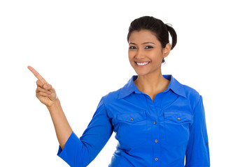 Happy young smiling woman gesturing pointing to space at left