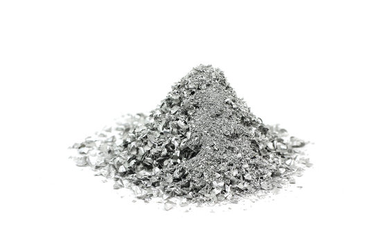 a handful of silver powder on a white background