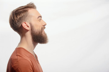Handsome bearded man posing on white