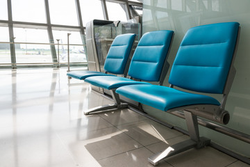 chair row in airport.,waiting space.