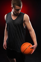 Caucasian basketball player holding the ball