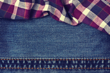 jeans background with plaid fabric in vintage style