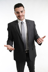 isolated young business man positive attitude