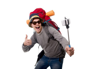 young traveler backpacker taking selfie photo with stick